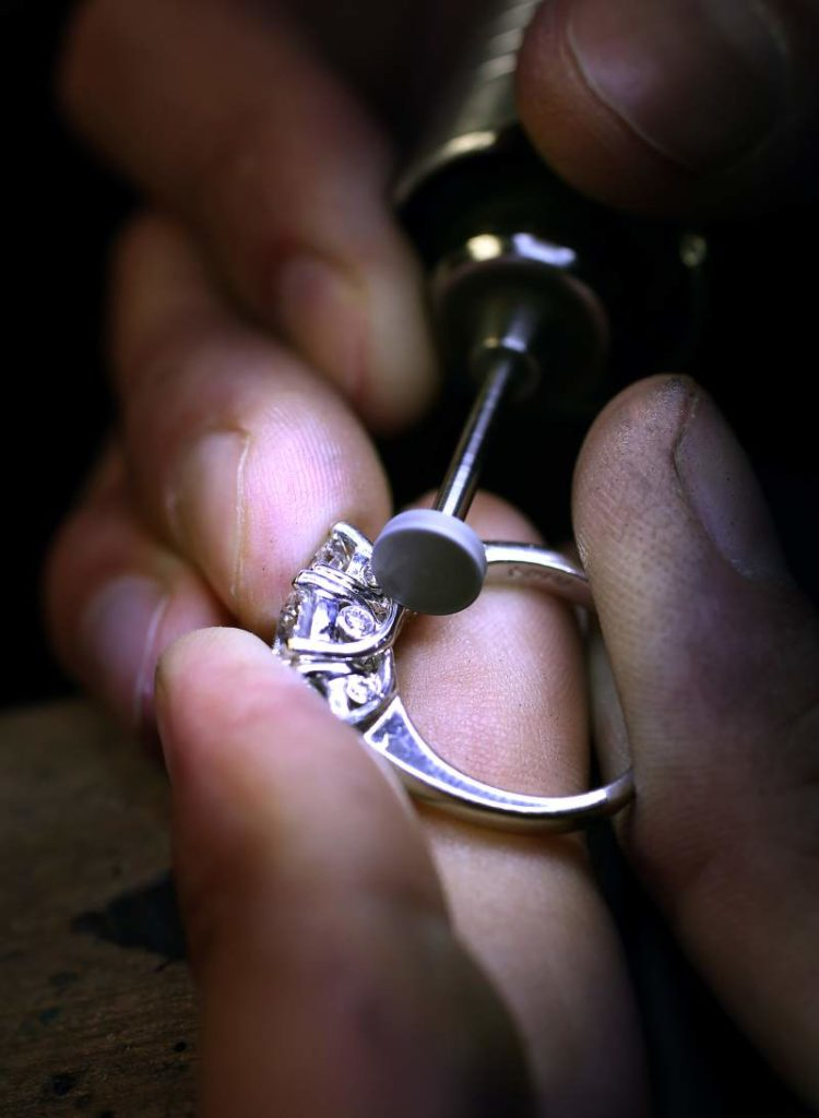 Hands cleaning a custom ring with special tool at E.R. Sawyer Jewelers Best of Sonoma County: E.R. Sawyer Jewelers