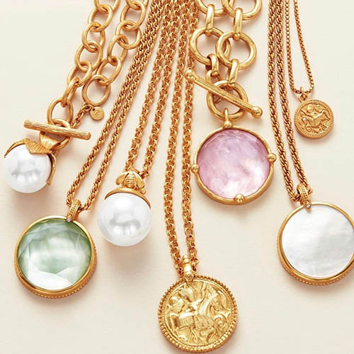 Julie Vos gold plated necklaces on light pink background